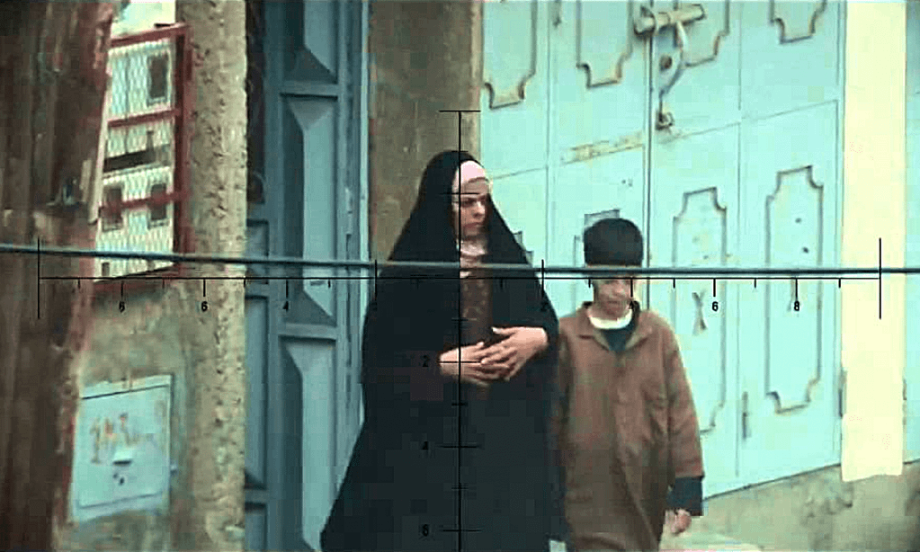 A still from the film American Sniper, showing a Muslim woman and her son be the target of a sniper.