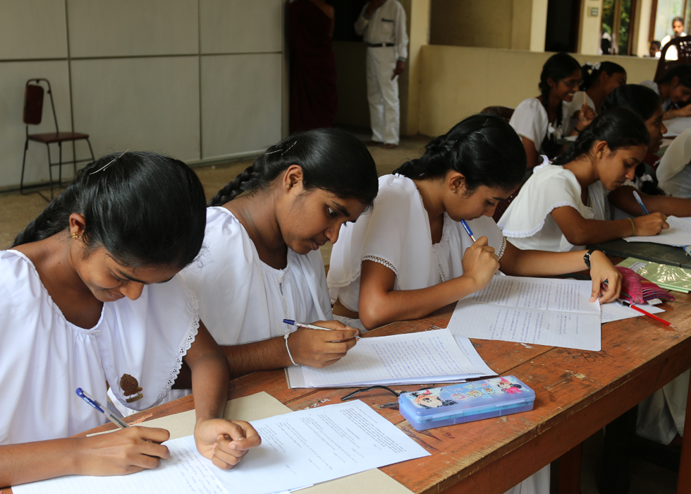 This week Sri Lankan students may face exams near a bombsite and a woman battles Islamophobia with a smile